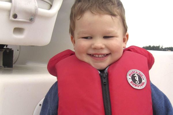 Child wearing a properly fitted life jacket.