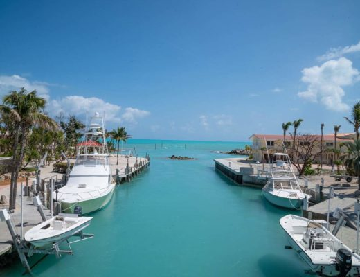 florida coast with moored boats along side of canal