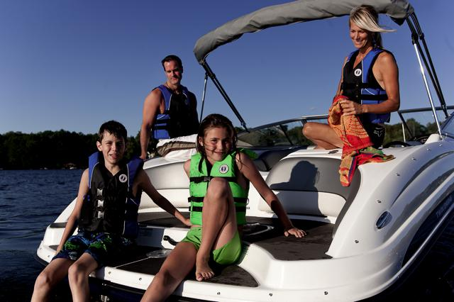 A family boating after buying a boat for the first time.