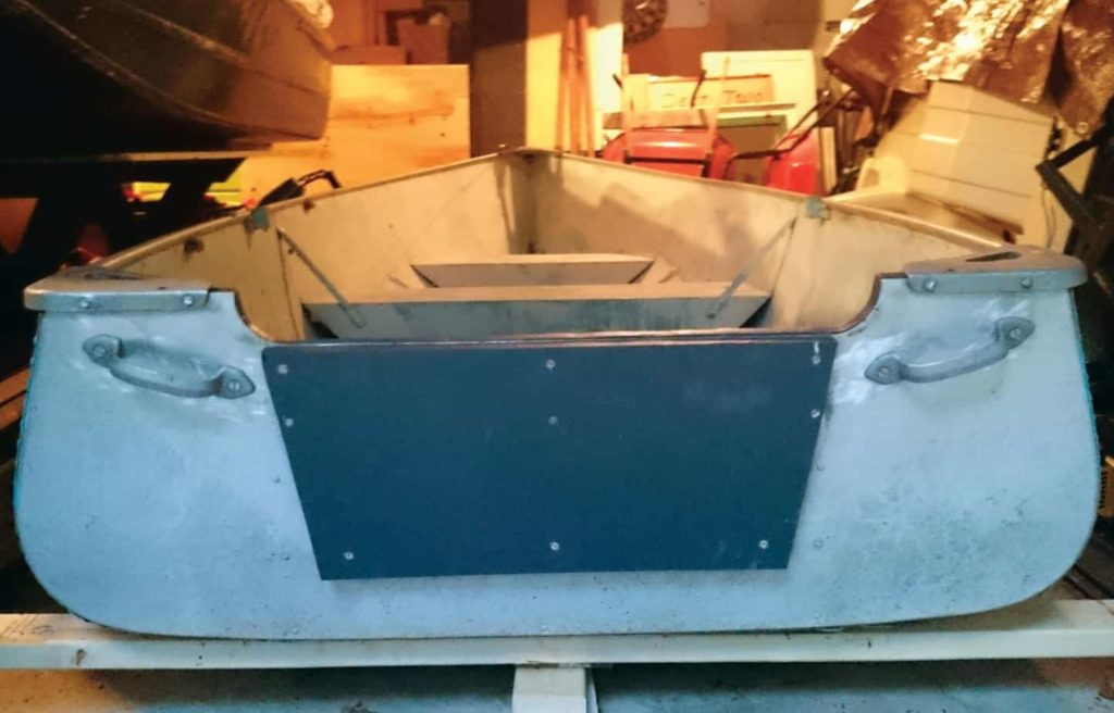 Image of an old tin boat transom after having been fixed and sealed.