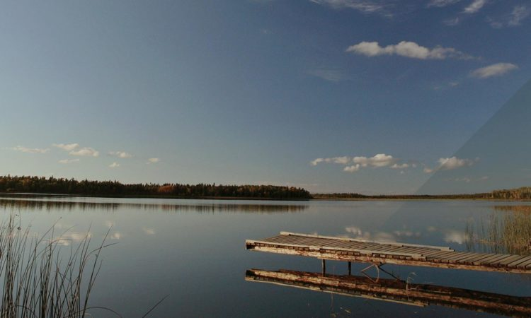 Dock overlooking calm lake in Manitoba